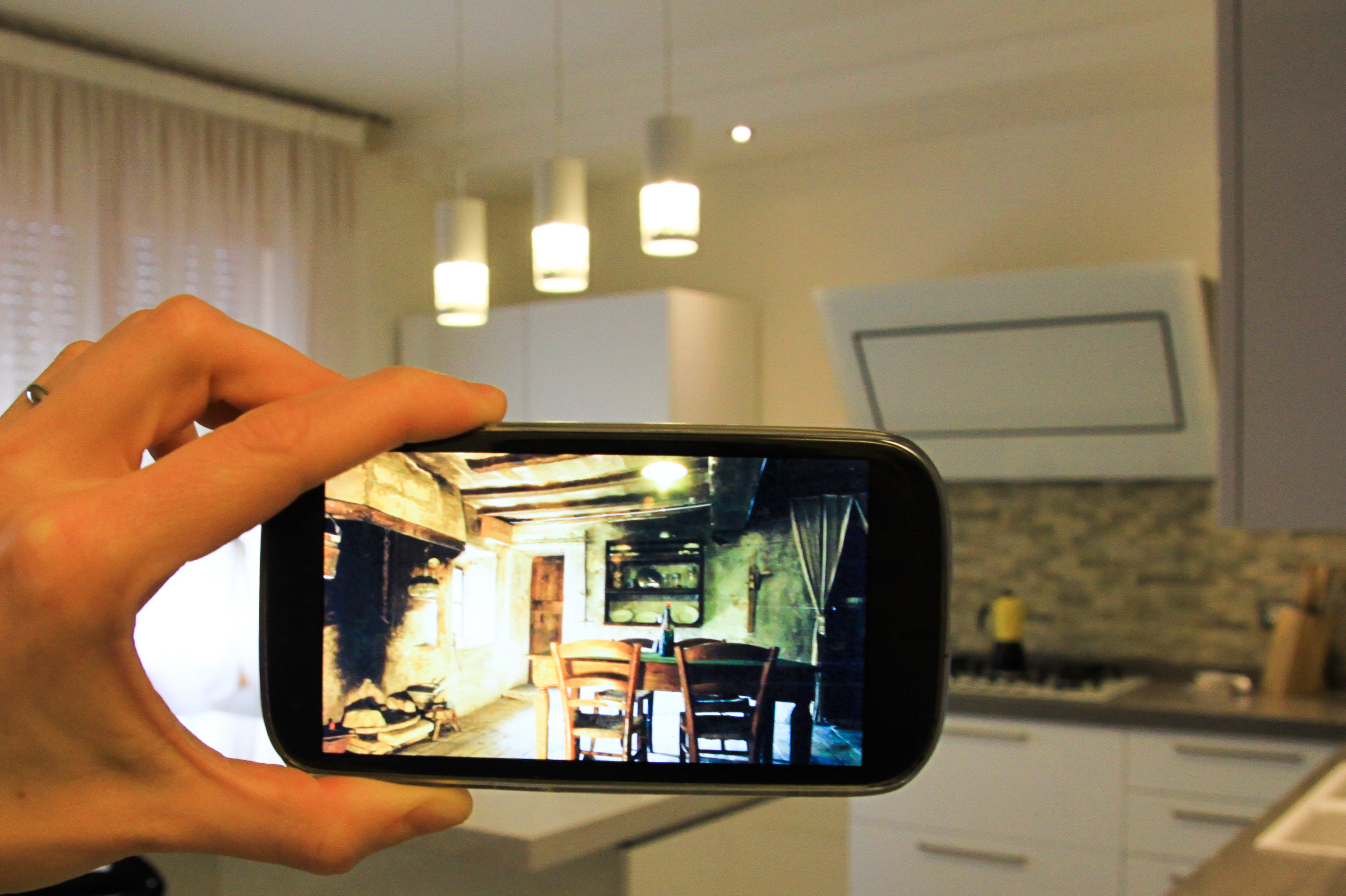 an idea with an smartphone and a modern kitchen