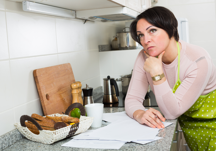Depressed woman reading bank refuse papers about delay of payment
