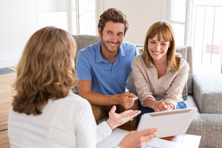 Happy young man and woman consulting plans digital PC real estate apartment
